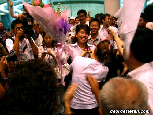WE DID IT!: DAP's Violet Yong and her supporters celebrate her winning the Pending seat at the 2006 Sarawak Elections. (© Georgette Tan, 2006)