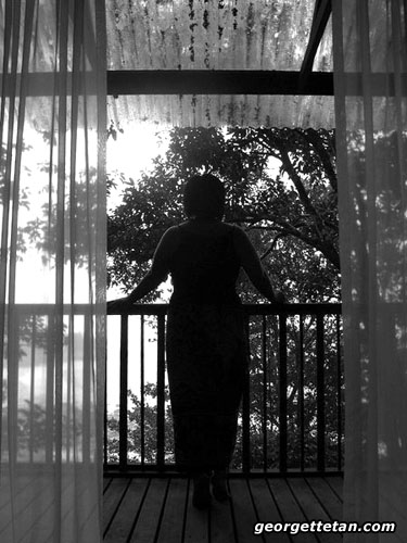 AWAY: A self-portrait at a tree house balcony at Permai Rainforest Resort. (© Georgette Tan, 2007)